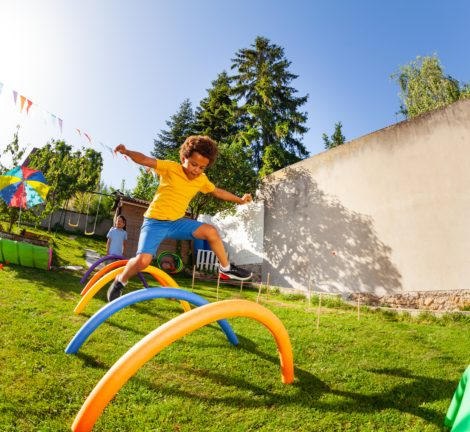 kids playing on structure in backyard of home